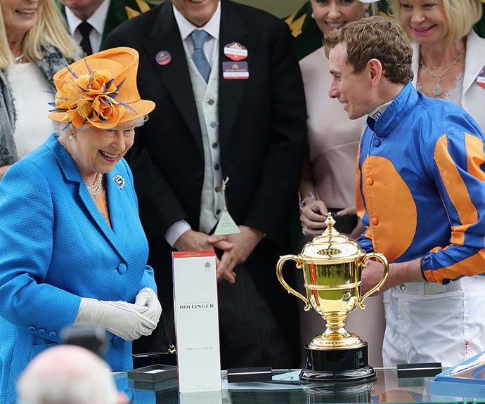 The Queen laughs off fashion *faux pas* in 2016, as she and a jockey notice they've couple-dressed for the occasion!