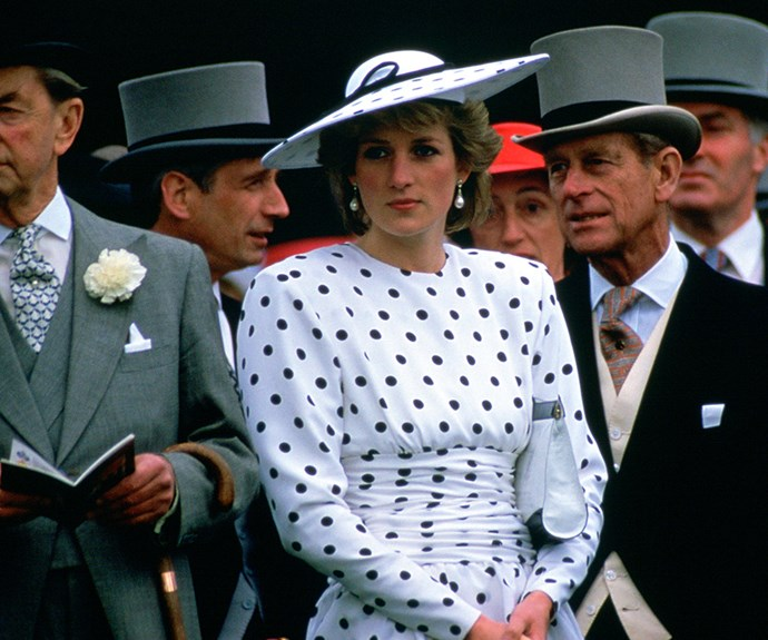 Diana poised in a polka dot day dress and matching hat designed by Victor Edelstein.