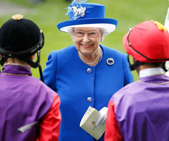 She was probably relieved she and the jockeys didn't wear the same colour.