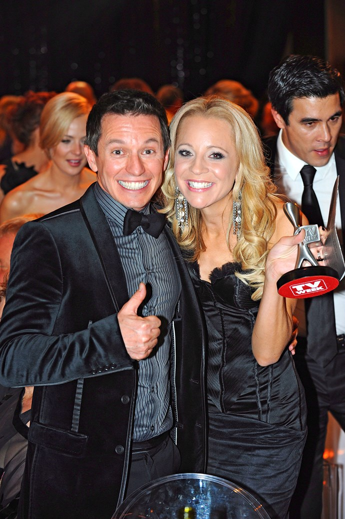 Rove celebrates Carrie Bickmore's win at the 2010 Logies.