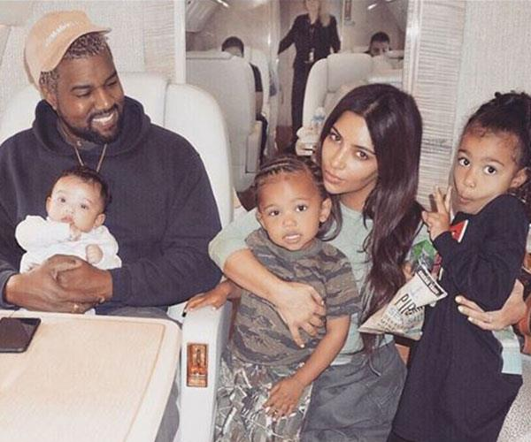 Kim Karadashian and Kanye West with their three children, daughter Chicago, son Saint, and daughter North.