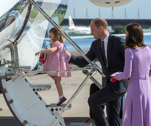 Prince William helps Princess Charlotte board a plane bound for London on the last day of the Cambridge's royal tour of Poland and Germany.
