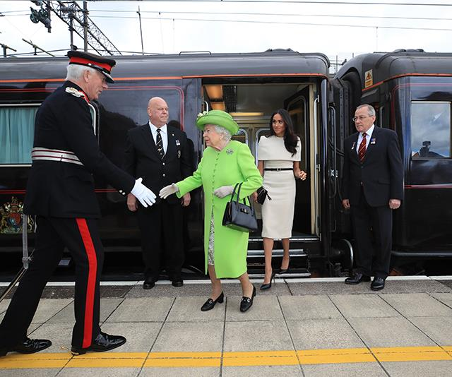 The Queen and Meghan Markle arrive on the Royal Train.