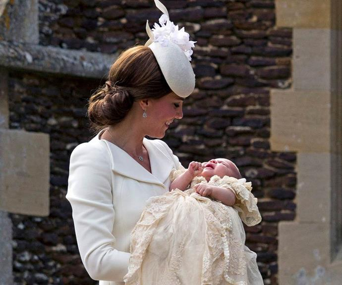 Duchess Catherine cradles Princess Charlotte at her 2015 christening.
