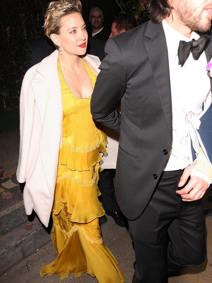 """Baby's night out! Dressed in canary yellow, Kate and Danny attended Gwyneth Paltrow and Brad Falchuk's [star-studded engagement party.](https://www.nowtolove.com.au/celebrity/celeb-news/gwyneth-paltrows-engagement-party-to-brad-falchuk-46511