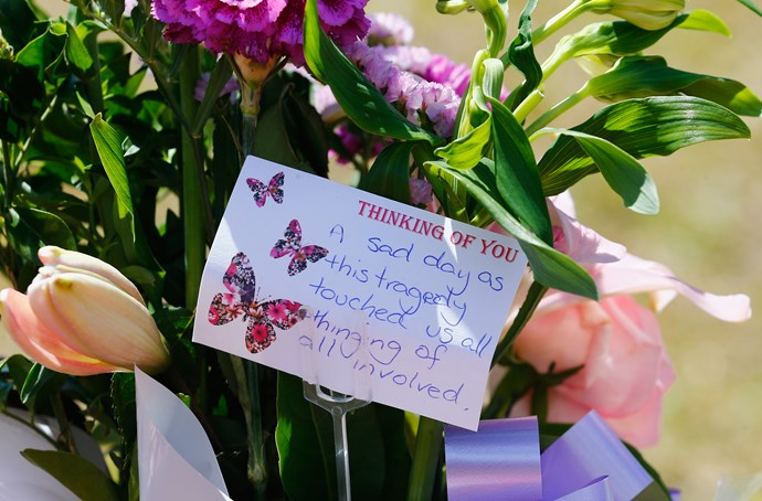 Floral tributes covered the entrance to Dreamworld in tribute to the four people killed on the Thunder Rapids ride. Source: Getty Images