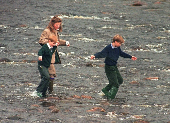Royal Nanny, Tiggy Legge-Bourke née Pettifer, Prince William, and Prince Harry walk in the River Gairn, near the Balmoral Estate on October 22, 1994.