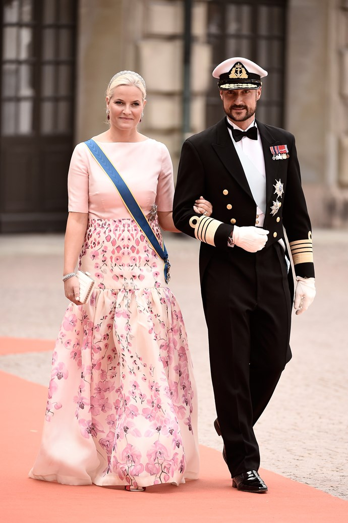 Crown Princess Mette-Marit of Norway chose a floral palette when she attended the royal wedding of Prince Carl Philip of Sweden and Sofia.