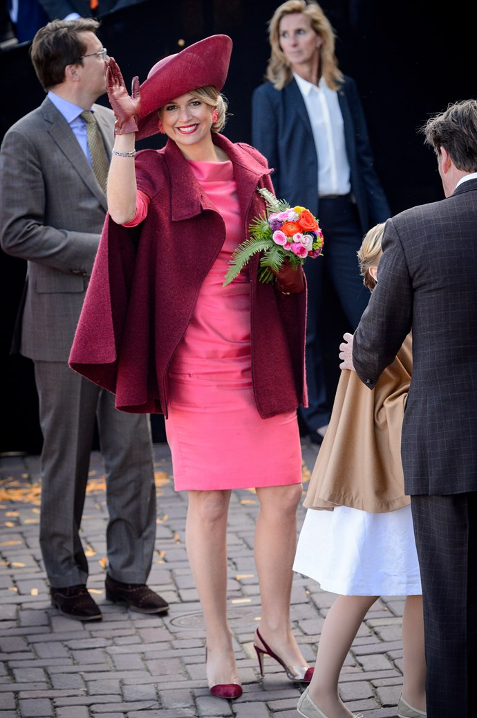 Queen Maxima of the Netherlands isn't afraid of clashing hues while celebrating King's Day in Holland.