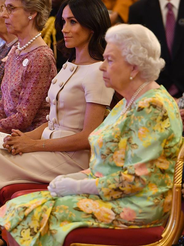 See Meghan's hands and posture? They're just like the Queen's!