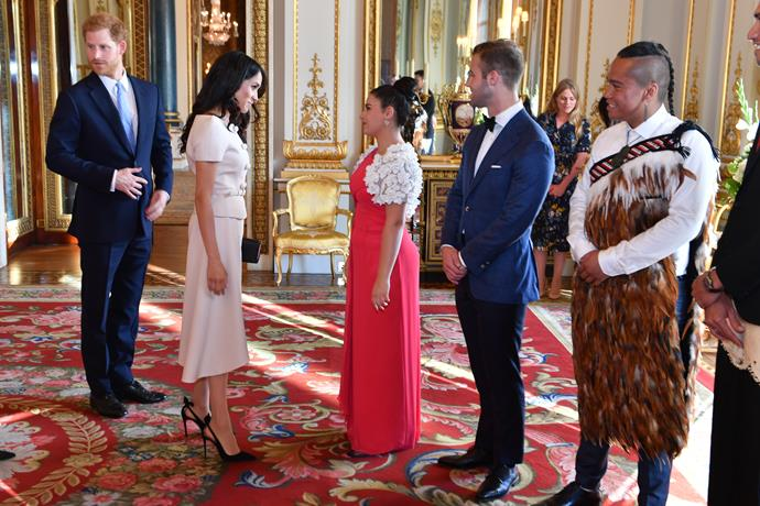 Meghan greeting young leaders at Buckingham Palace on June 26.