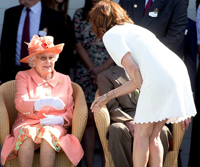 Queen Elizabeth happily shakes Susan's hand despite it being against royal protocol to do so.