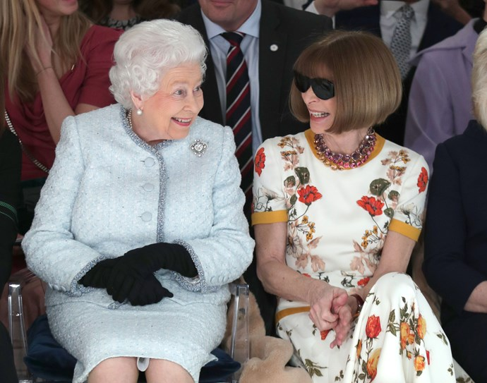 The Queen sitting front and centre (with her knees facing forward) with *Vogue* editor Anna Wintour during last year's London Fashion Week.