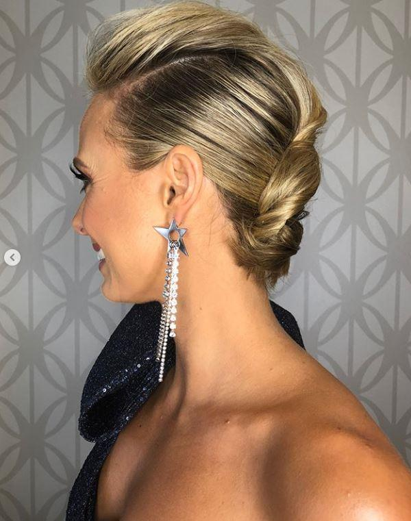 We don't know what we love more: Sylvia's modern twist on a French braid or her glittery star earrings.