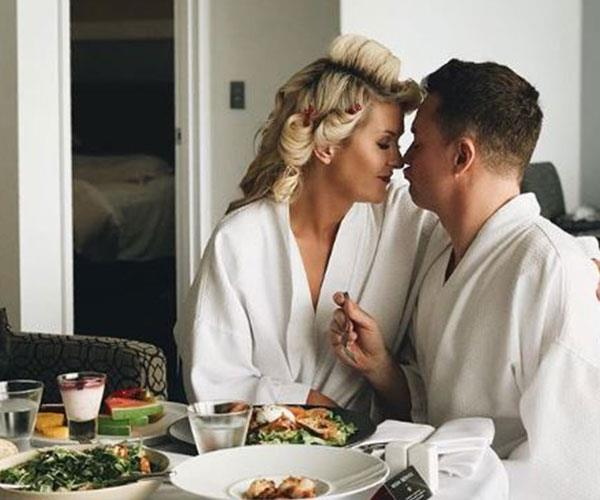 The Denyers shared a romantic snap from their Gold Coast hotel room.