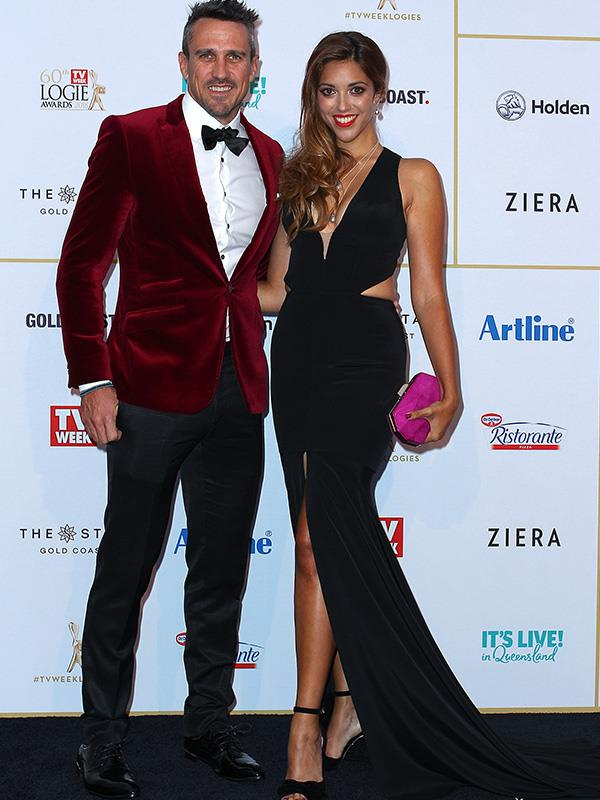 *Survivor* runner-up Lee Carseldine and actress Kristy Best are all smiles at the Logies. We love that Lee matched his velvet jacket to the ruby-red carpet he's about to step out on to!