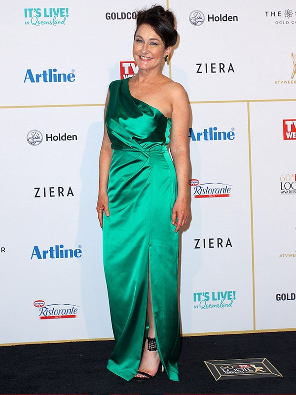 Hello, Fiona O'Loughlin! All greened up and glitzy, she's certainly come a long way since toughing out in *I'm A Celebrity! Get Me Out Of Here!* - but to be honest, no matter where she is, or what she's wearing, Fiona's always a treasure to us.