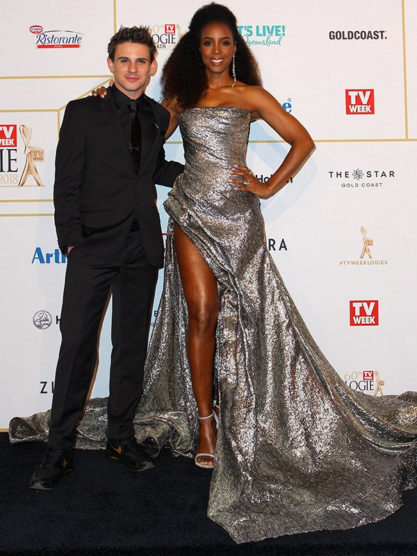Oh-so glamorous Kelly Rowland standing by *The Voice* winner, Sam Perry.