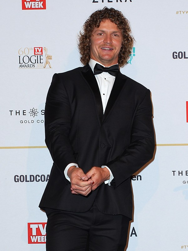 All smiles and long, curly locks, New Bachie Nick 'Honey Badger' Cummins made an entrance at the Logies.