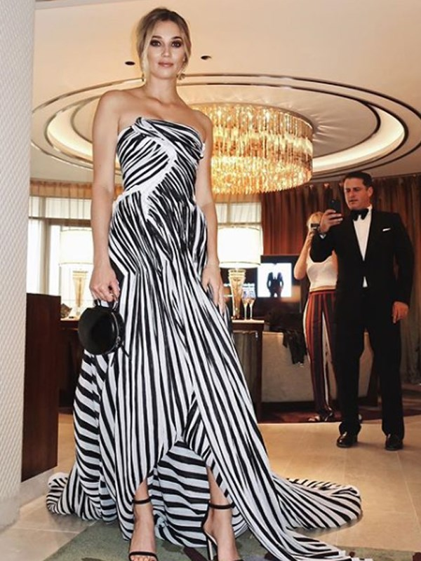 """One of us scrubbed up alright,"" Karl wrote alongside a pre-Logies snap of his stunning fiancee wearing Toni Maticevski."
