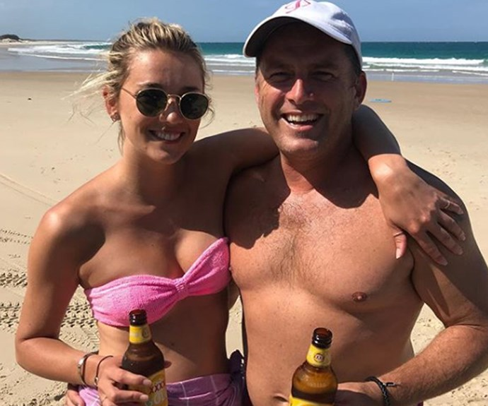 The couple's low-key Valentine's Day - beers on the beach.