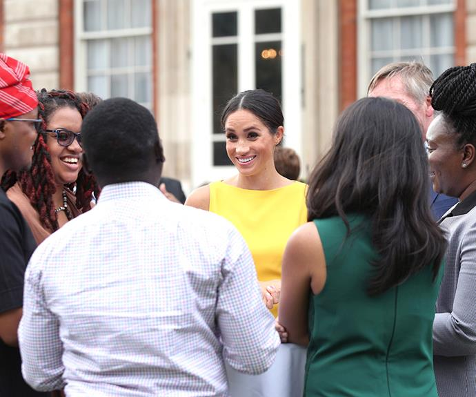 Meghan chats youngsters at the Your Commonwealth Youth Challenge reception last week at Marlborough House in London.