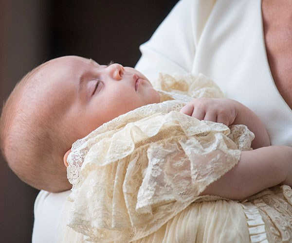 So serene: The perfect prince sleeps in his mother's arms.