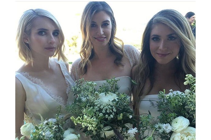 She might not be smiling, but Emma Roberts' was said to be proud as punch to stand by her friend, Kara Smith, on her special day.