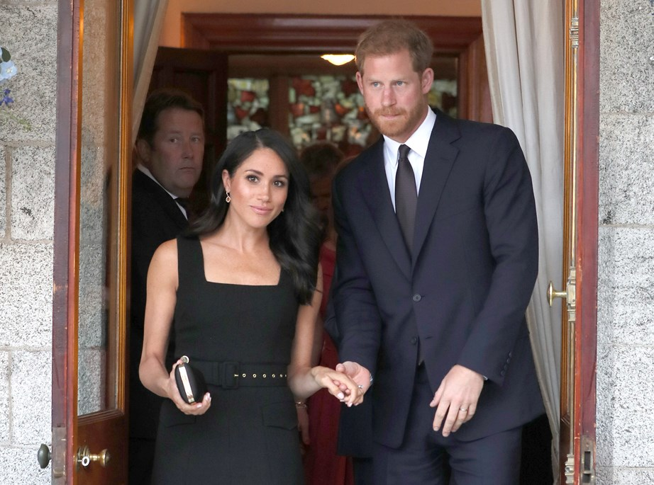 Harry and Meghan arrived at the garden party hand-in-hand.
