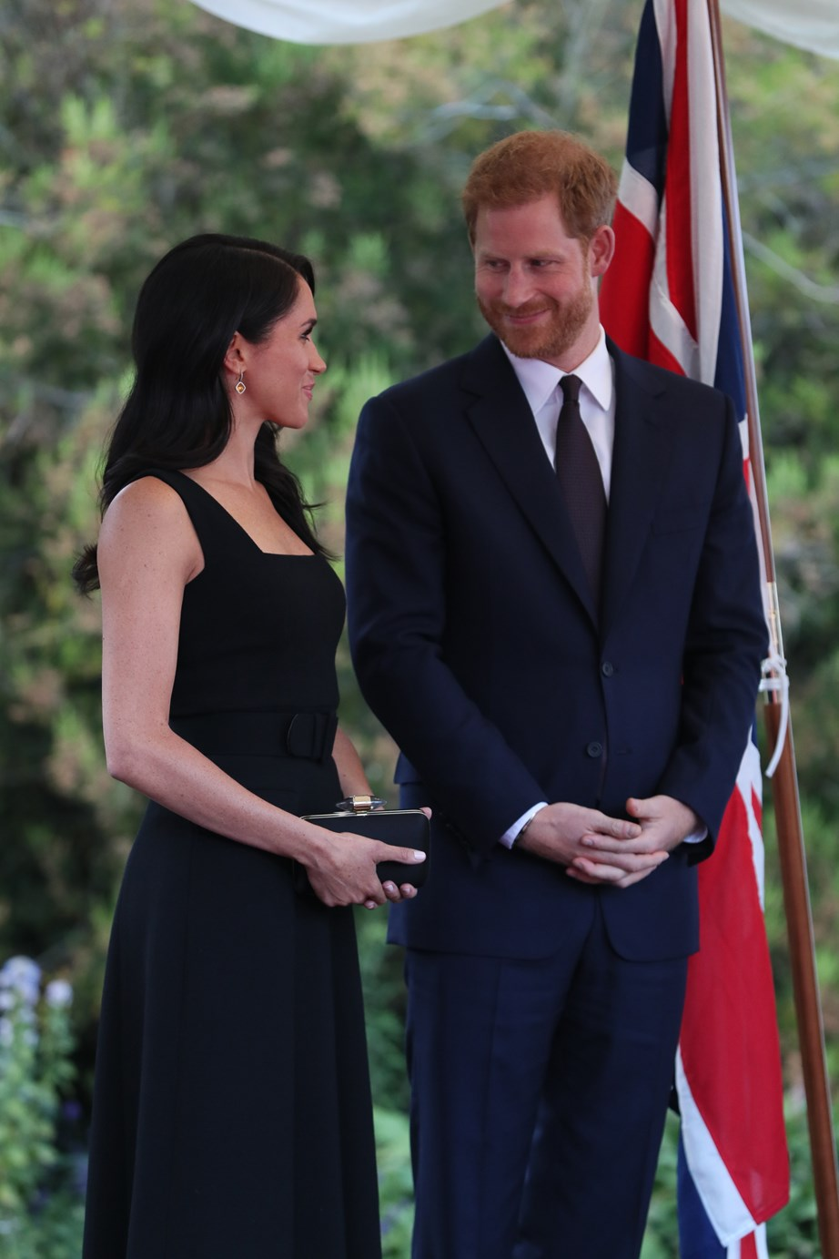 Harry couldn't take his eyes of of Meghan - who looked stunning in a dress from New Zealand designer Emilia Wickstead.