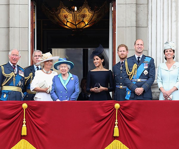 A royal promotion! Meghan Markle stands next to The Queen during the RAF fly-over.