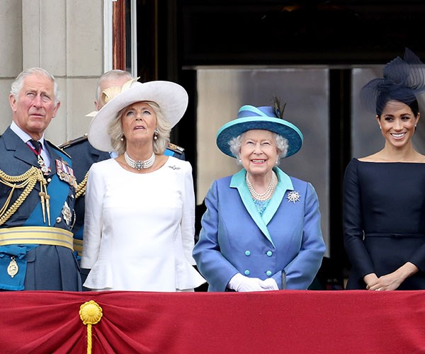 Prince Charles, Duchess Camilla, The Queen and Meghan Markle take centre stage on the balcony.