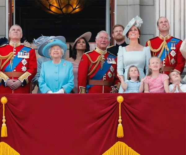Prince Harry and Meghan Markle stood in the back row at Trooping the Colour last month.