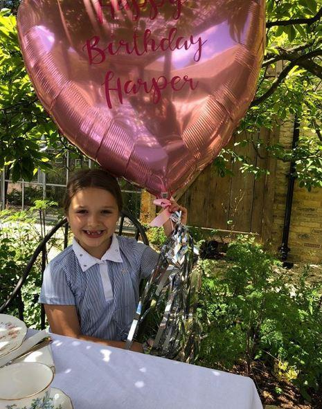 What's sweeter: Harper's birthday balloon or her gorgeous, gappy grin?!