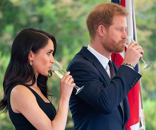 Meghan Markle enjoys what looks to be a glass of champers during the Royal tour of Ireland.