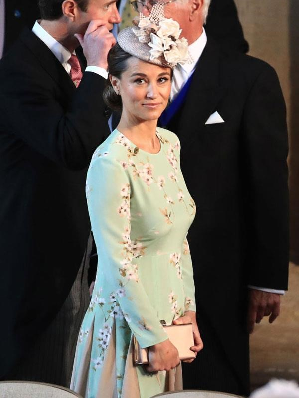 """This was the first glimpse the world was given of Pippa Middleton's tiny baby bump when she attended [Prince Harry and Meghan Markle's wedding in May](https://www.nowtolove.com.au/royals/british-royal-family/pippa-middleton-pregnancy-baby-bump-at-royal-wedding-48535