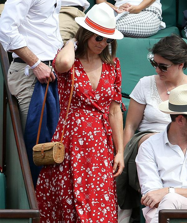 The 34-year-old added a casual edge with a red and white panama hat and aviators.