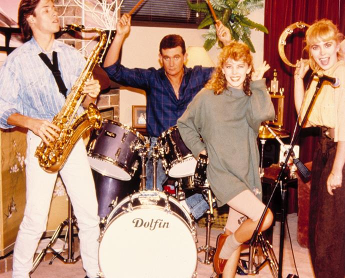Guy (far left) and Kylie (second from right) during their *Neighbours* days.