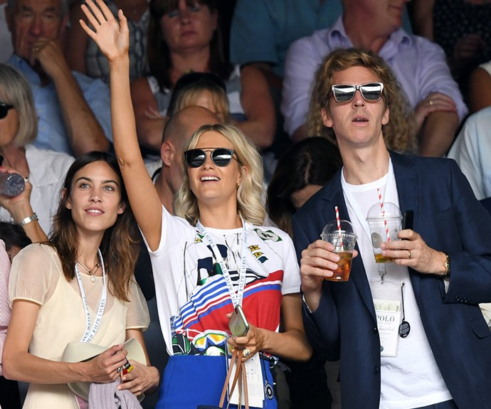 The gang's all here! Model and presenter Alexa Chung, model Poppy Delevingne and her husband James Cook sip Pims on day seven of the tournament.