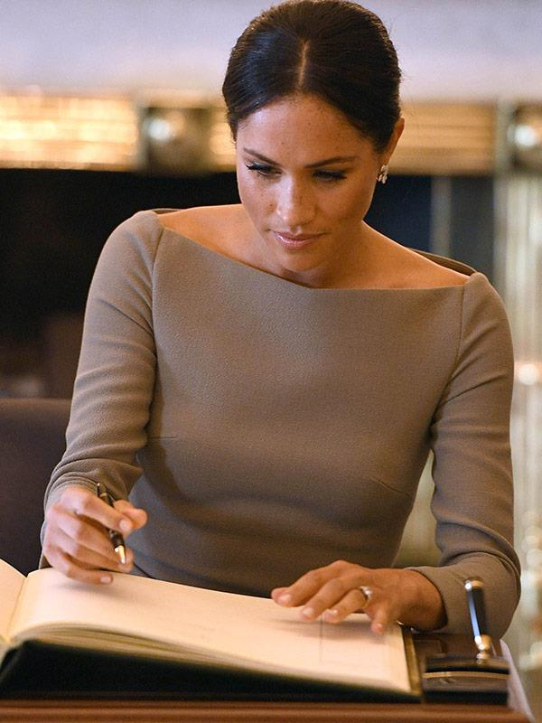 Meghan shows off her signature.