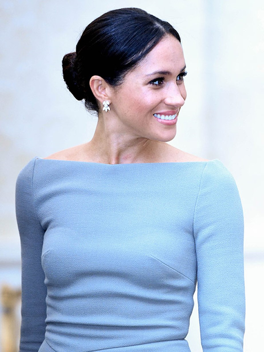 Astute fans will recognise that Meghan actually owns this dress in navy, which she wore the day before she married Prince Harry.