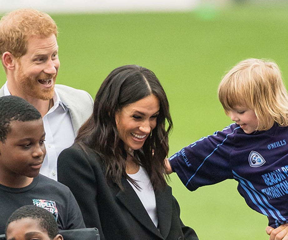 Three-year-old Walter Kieran trying to touch Meghan's hair.