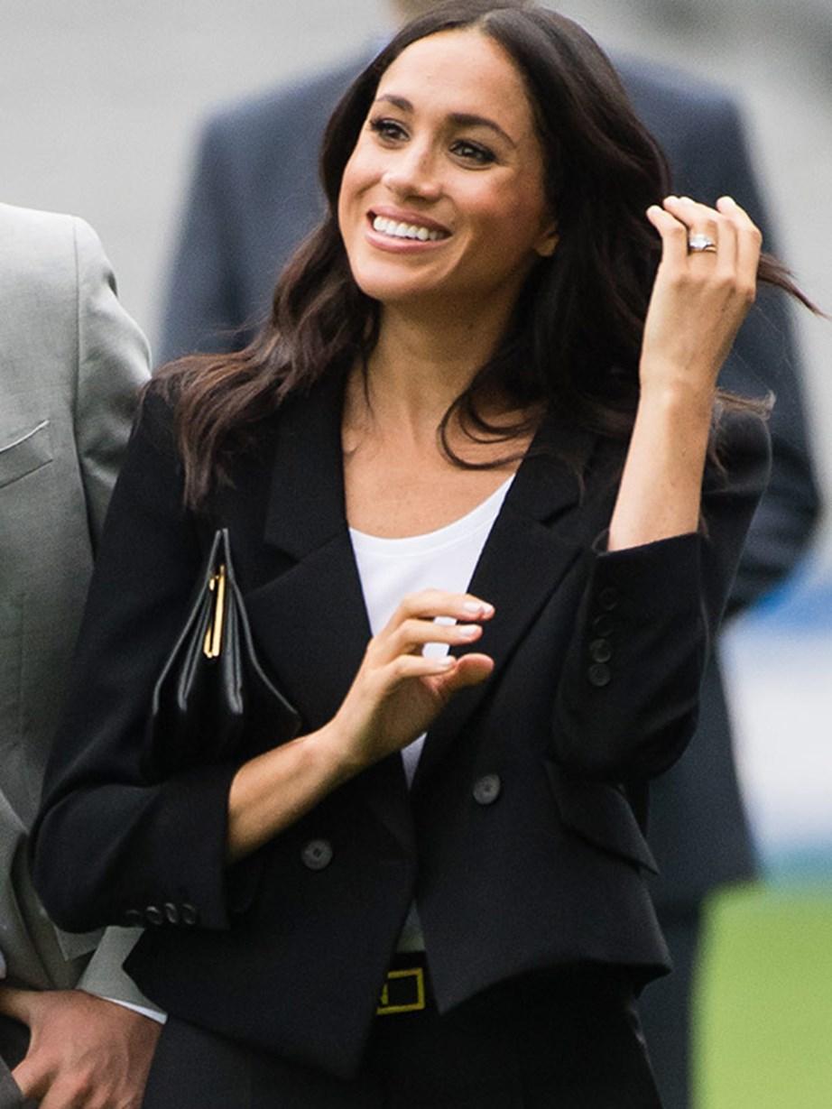 Her stunning wedding ring shines as her key jewel.