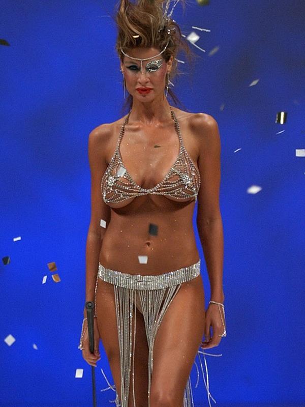 Nicola describes her breast implants as the biggest regret of her life.