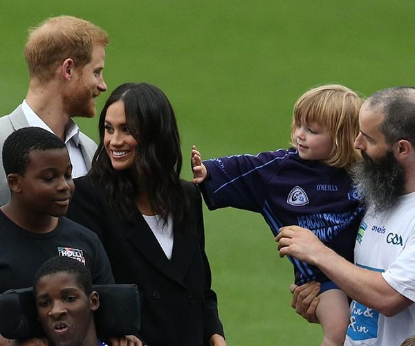 Three-year-old Walter Kieran reaches for Meghan's lovely locks.