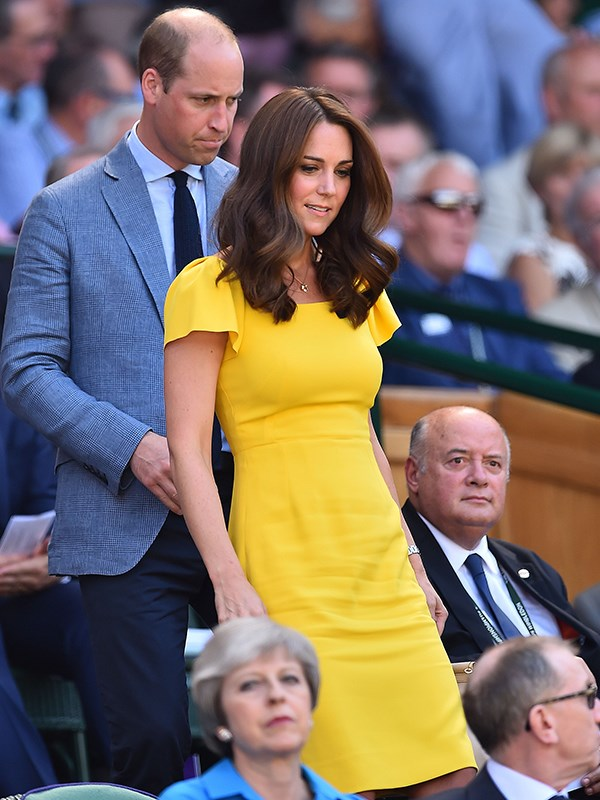 Prince William and Kate walked to their seats in the Royal Box on Sunday ahead of the men's final at Wimbledon.
