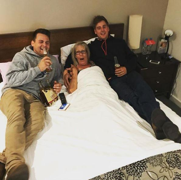 """Hope ya got ya trousers on under there!"" The brothers cuddled up with fellow contestant, Kim."