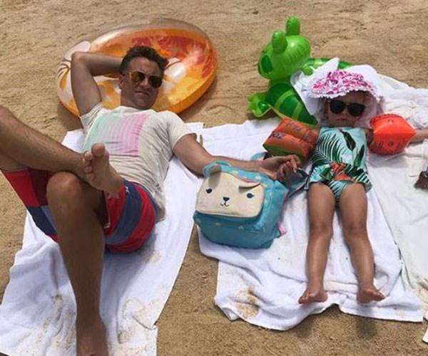 Chris and Evie kick back on the beach.