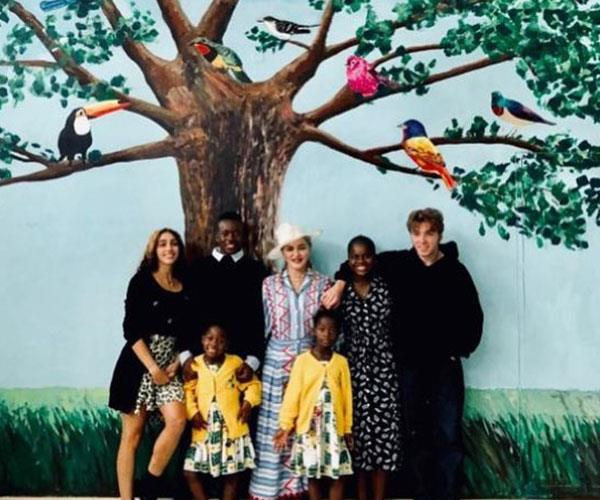 What a shot! Madonna is surrounded by all six of her kids.