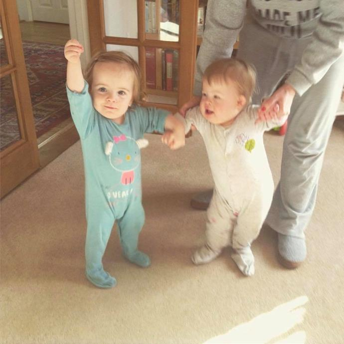 Jessica supporting her brother Jack to stand.  **Facebook: twinsmylifeupsidedowns**